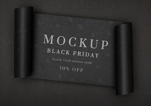 Bannière roulée de maquette de vente vendredi noir fond noir