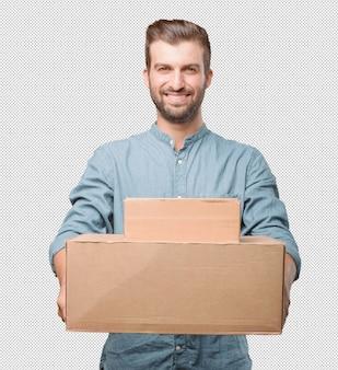 Beau jeune homme tenant des boîtes