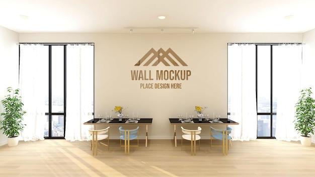 Beau texte 3d de luxe ou maquette de logo sur le mur du restaurant