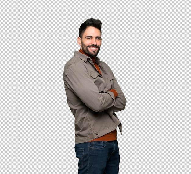 Bel homme à la barbe avec les bras croisés et impatients