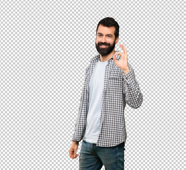 Bel homme à barbe montrer signe ok avec doigts