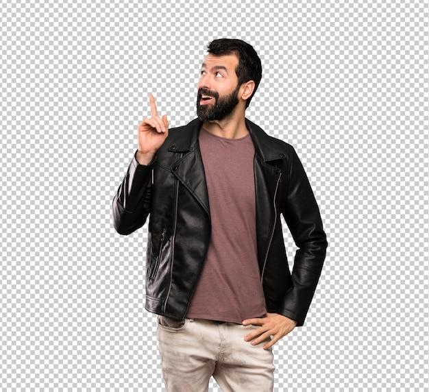 Bel homme à la barbe pensant une idée pointant le doigt vers le haut