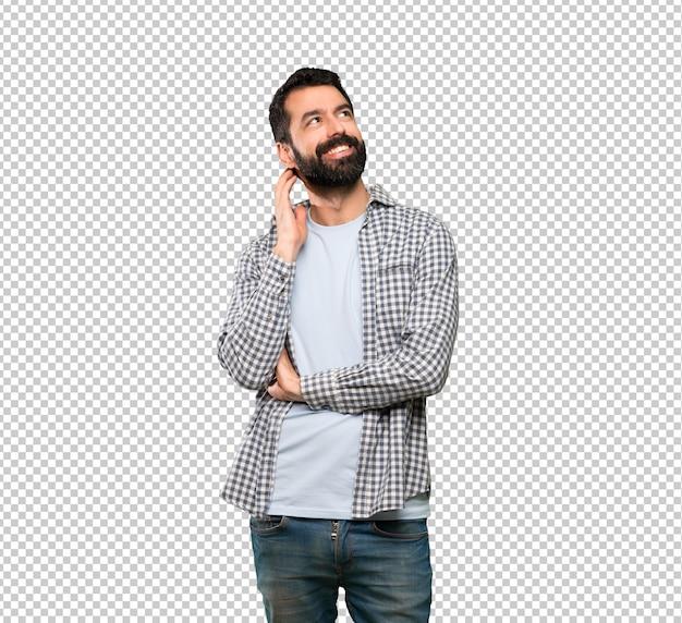 Bel homme à la barbe pensant une idée