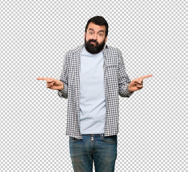Bel homme à la barbe pointant vers les latéraux ayant des doutes