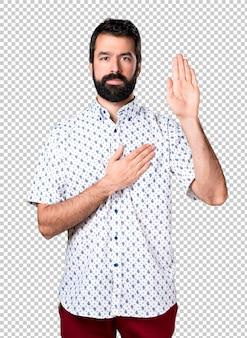 Bel homme brune à la barbe prêtant serment