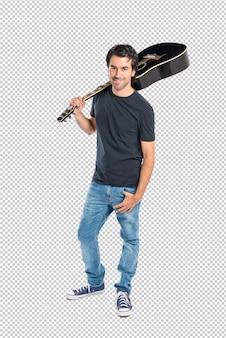 Bel homme avec guitare sur fond blanc