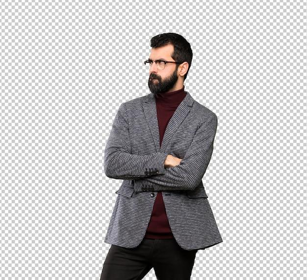 Bel homme avec des lunettes avec une expression du visage confuse