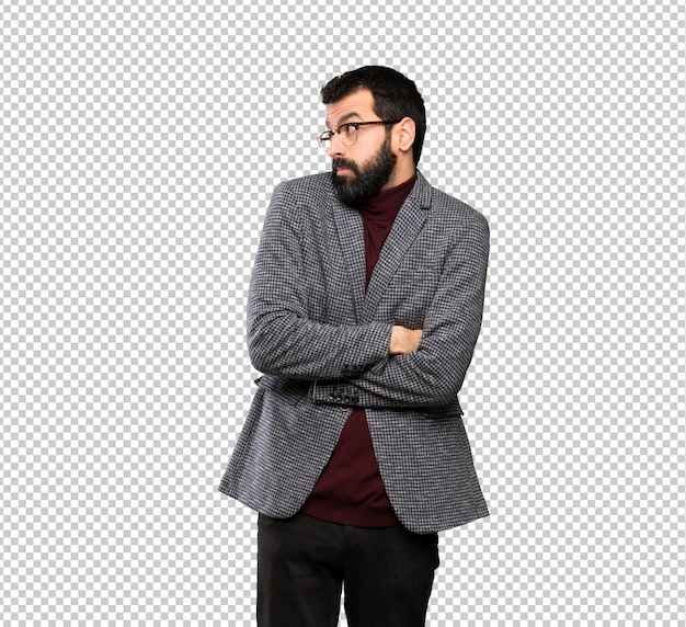 Bel homme avec des lunettes faisant des gestes de doutes tout en soulevant les épaules