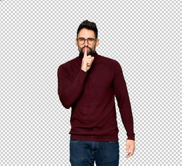 Bel homme avec des lunettes montrant un geste du silence mettant le doigt dans la bouche