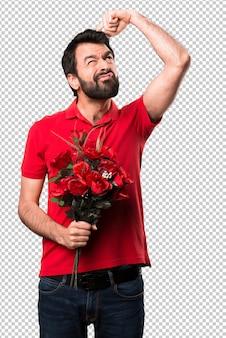 Bel homme tenant des fleurs avoir des doutes