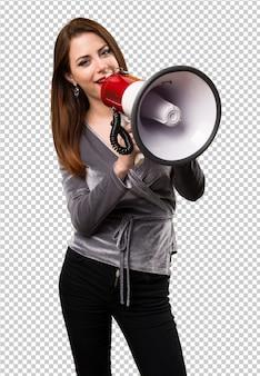 Belle jeune fille tenant un mégaphone