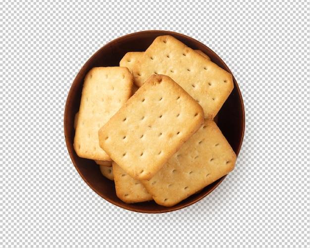 Biscuits de craquelins dans un bol en bois, découpe avec ombre.