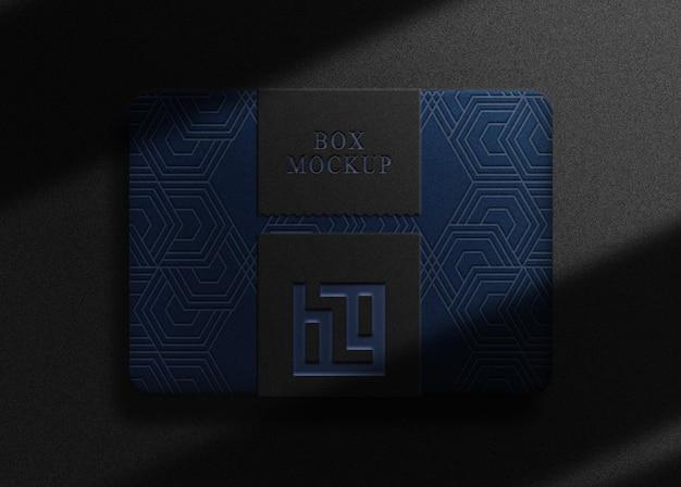 Boîte bleue en relief en or de luxe avec maquette de sceau