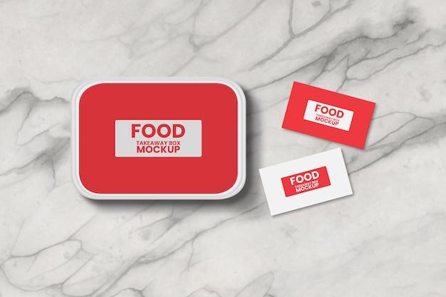Boîte de livraison de plats à emporter avec maquette de carte de visite