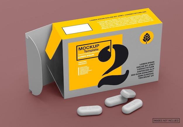 Boîte de papier ouverte et maquette de pilules