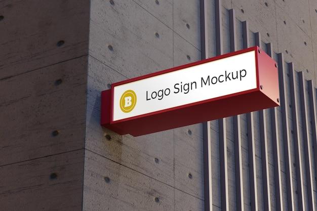 Boîte de signalisation rectangle maquette signe logo sur la façade de l'immeuble de bureaux