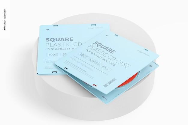 Boîtiers de cd en plastique carrés sur une maquette de surface