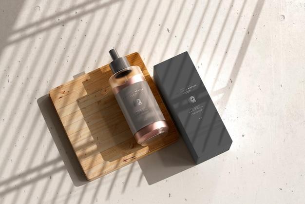 Bouteille de crème cosmétique avec maquette de boîte