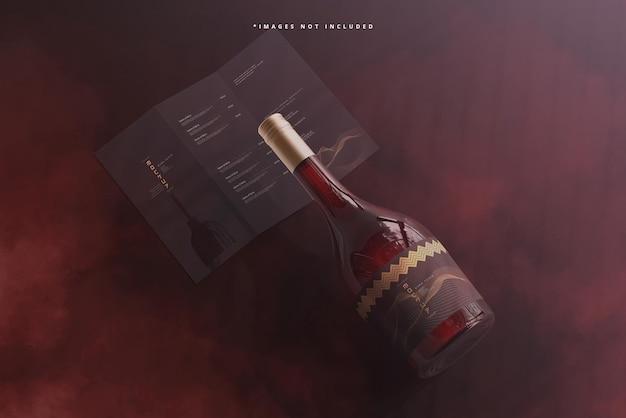Bouteille de vin à bouchon à vis avec brochure ou maquette de menu