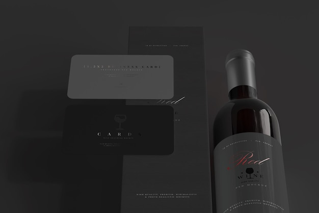 Bouteille de vin rouge avec boîte et maquette de carte de visite