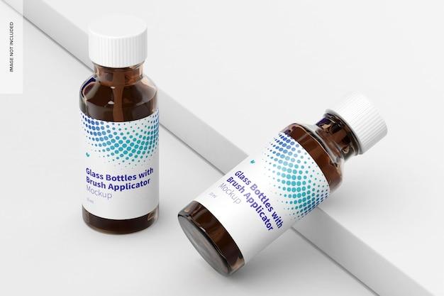 Bouteilles en verre avec maquette d'applicateur de brosse, vue de gauche