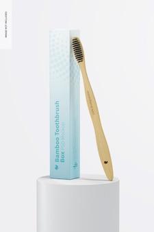 Brosse à dents en bambou avec boîte sur maquette de surface