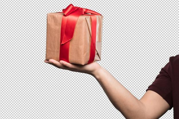 Cadeau en carton avec un mensonge rouge sur blanc