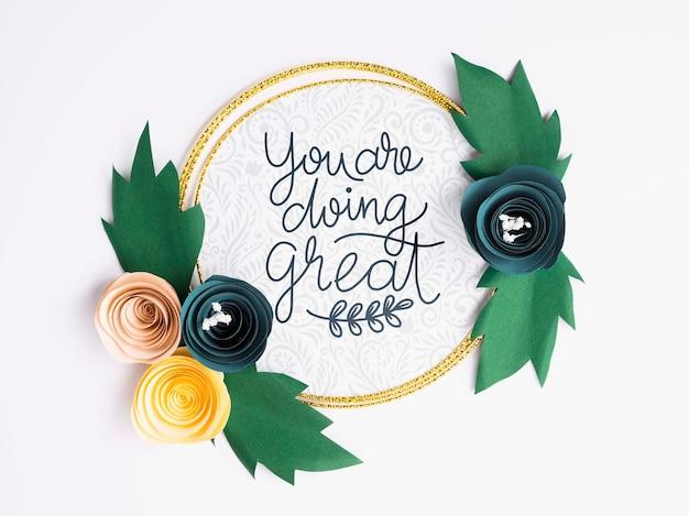 Cadre de fleurs artistiques avec citation de motivation