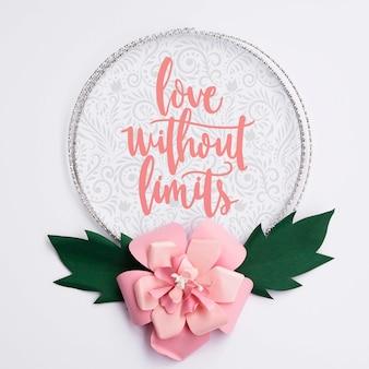 Cadre de fleurs artistiques avec un message inspirant
