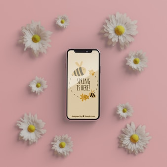 Cadre floral avec maquette de téléphone