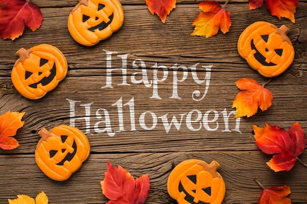 Cadre de maquette avec des friandises d'halloween