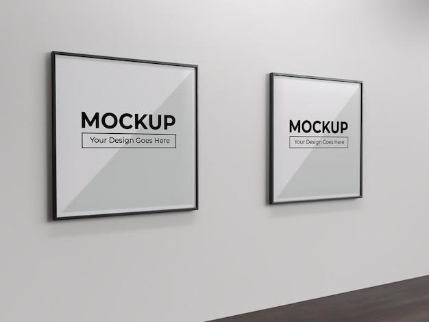 Cadre photo et affiche de peinture carrée sur maquette d'intérieur de mur