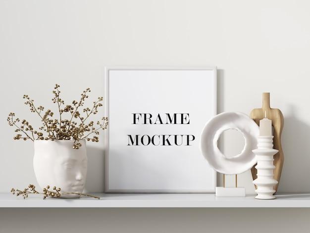 Cadre photo blanc à côté de la maquette de rendu 3d d'accessoires intérieurs