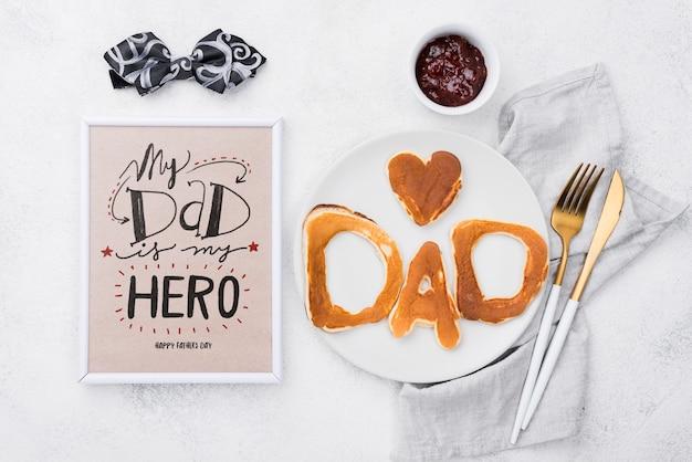 Cadre pour la fête des pères avec assiette de crêpes