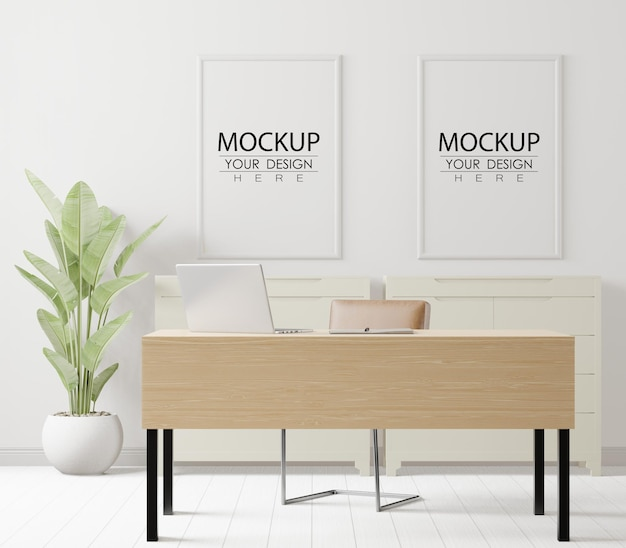 Cadres d'affiche dans la maquette de bureau