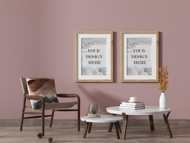 Cadres muraux en bois dans un salon de couleur rose avec chaise et table basse