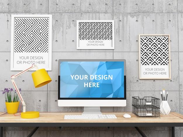 Cadres et ordinateur dans une maquette de bureau