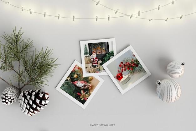 Cadres photo en papier avec boule de noël et maquette de feuille de pin