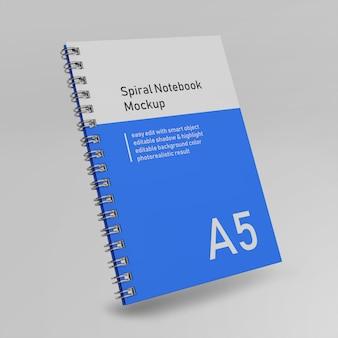 Cahier de journal intime premium relié à la reliure à spirale pour ordinateur portable maquette modèle de conception voler en face vue en perspective