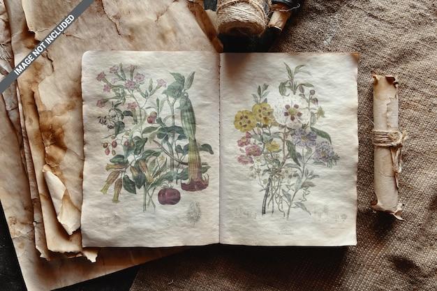 Cahier vintage ouvert avec de vieilles feuilles de maquette en papier