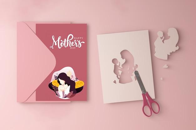 Carte de fête des mères et ciseaux avec maquette