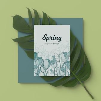 Carte de printemps avec feuille 3d sur table