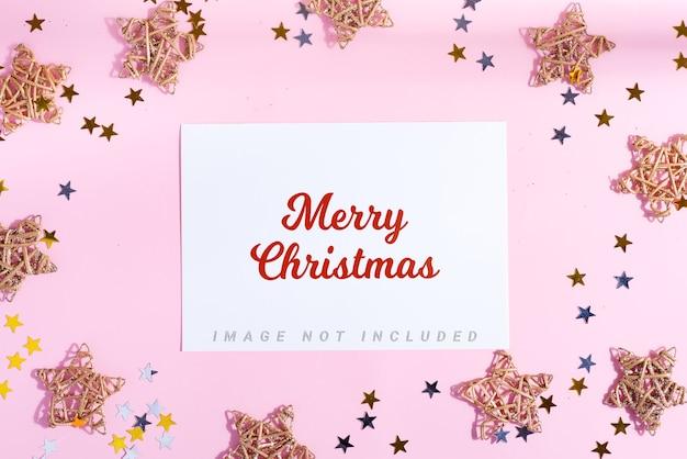 Carte de voeux joyeux noël avec étoiles et décoration de confettis lumineux