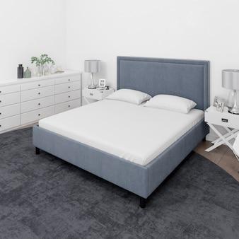 Chambre avec lit double et mobilier blanc