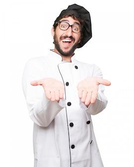 Chef drôle avec chapeau noir