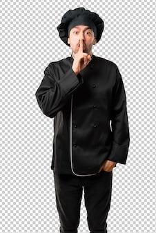 Chef homme en uniforme noir montrant des signes de fermeture de la bouche