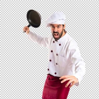 Chef tenant poêle
