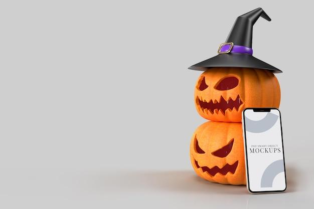 Citrouilles de maquette d'halloween, chapeau de sorcière avec smartphone. maquette de concept d'halloween