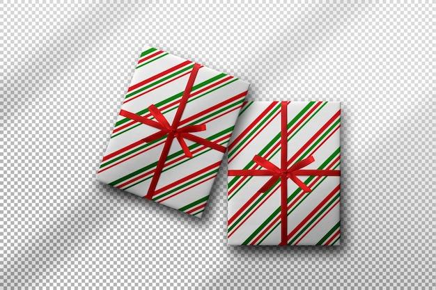 Coffret cadeau emballé avec une maquette de papier à motifs de lignes avec une ombre