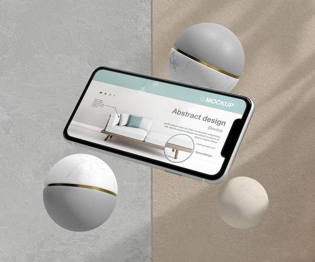 Composition de maquette de smartphone avec des éléments en pierre et métalliques